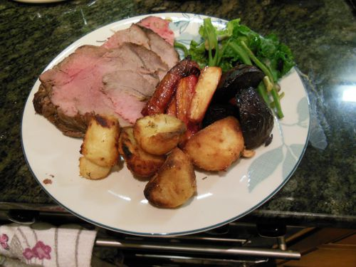 The finished roast beef, with honey roasted carrots, parsnips and beetroot, roast potatoes, runner beans and flower sprouts